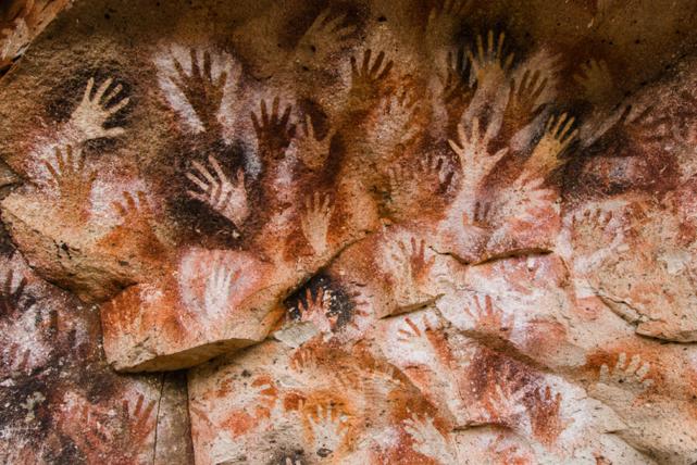 Hand stencils dating from 5,000–7,000 BCE photographed on the Cueva de las Manos, Santa Cruz, Argentina by Javier Etcheverry, 2015. Courtesy: Javier Etcheverry